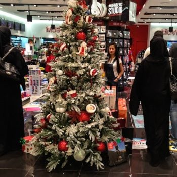 UNITED ARAB EMIRATES: Merry National Happy Day Christmas: Holidays In a Flat World