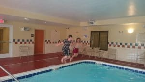 Autism boy and his brother at the hotel pool
