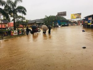 People Wade Through the Flood Waters